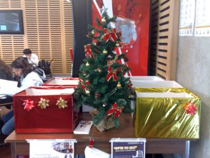 Table with boxes and Christmas tree