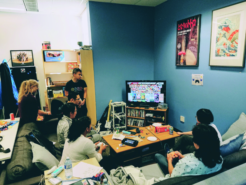 People playing Super Smash Bros in the Cube lounge